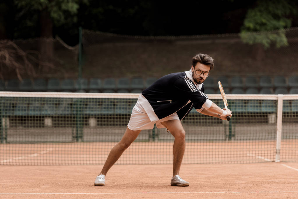 retro styled handsome tennis player playing tennis - Photo, Image