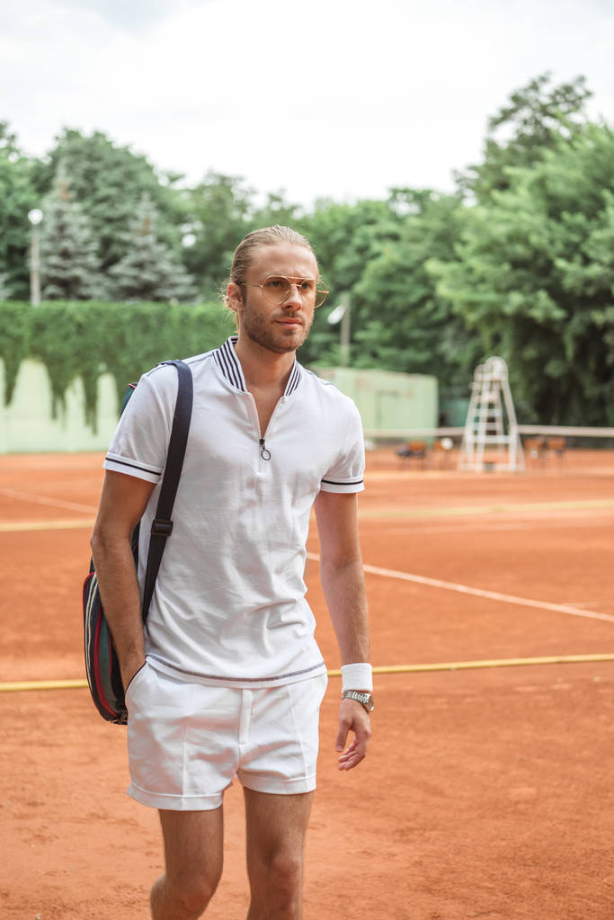 handsome tennis player after training on tennis court  - Photo, Image