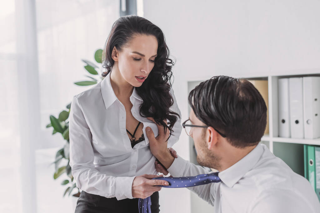 Breast touching pics Young Businessman Touching Breast Of Sexy Colleague Seducing Him In Office Free Stock Photo And Image