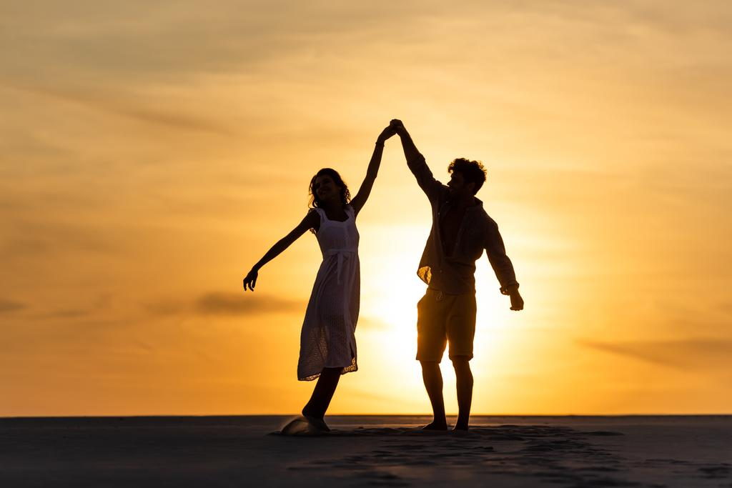 Silhouettes Of Man And Woman Dancing On Free Stock Photo and Image