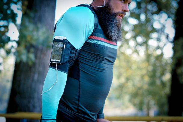 Man wearing armband for smartphone  - Photo, Image