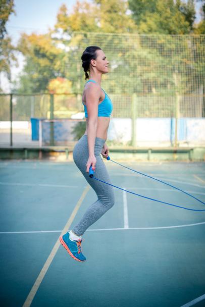 Active woman using jump rope - Photo, Image