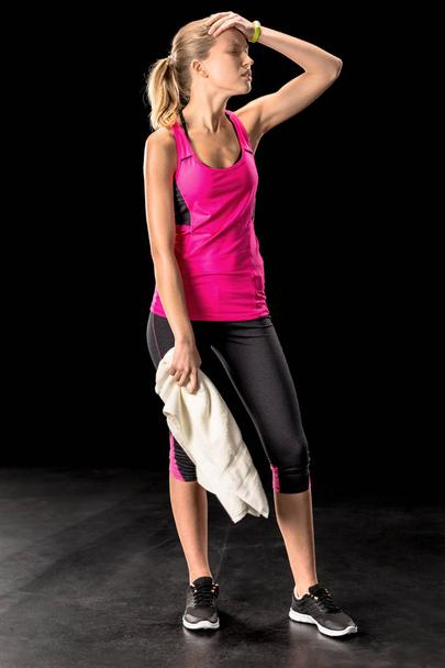 Upset sportswoman with towel - Photo, Image