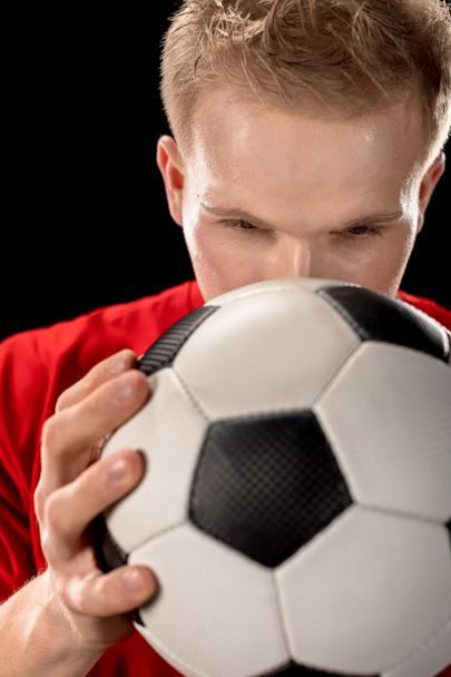 Soccer player holding ball - Photo, Image