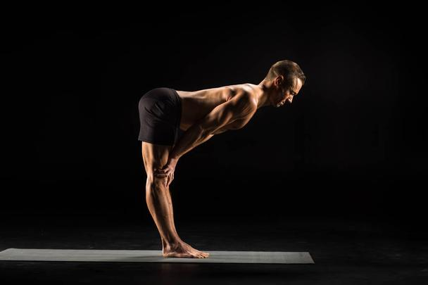 Man standing in yoga position - Photo, Image