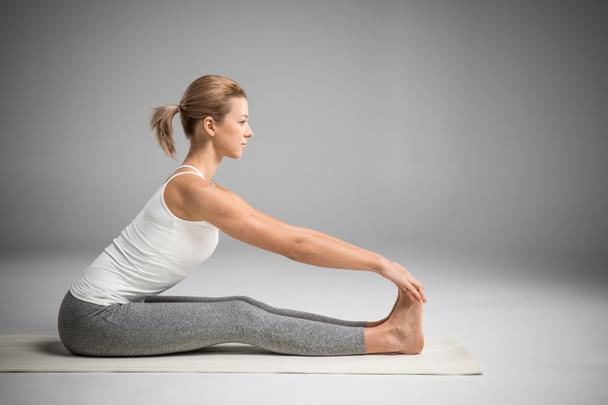 Woman sitting in yoga position  - Photo, Image