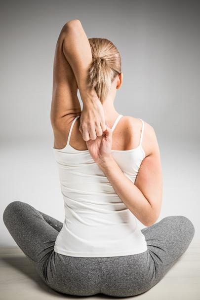 Athletic woman stretching - Photo, Image