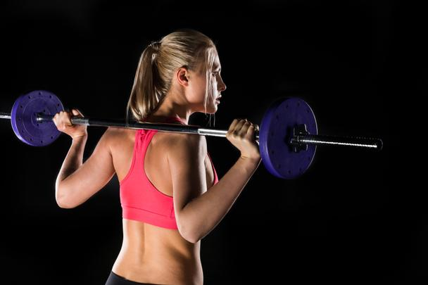 woman exercising with barbell - Photo, Image