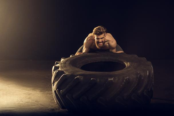 sportsman training with tire - Photo, Image