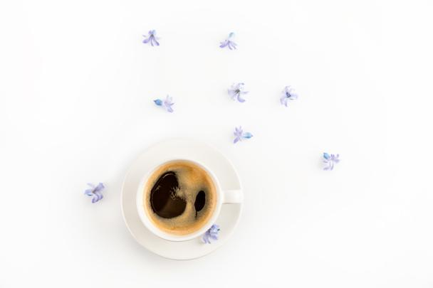 Cup of coffee and flowers  - Photo, Image