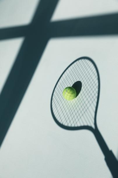 tennis racket and ball on floor  - Photo, Image