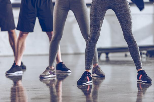 sporty people exercising in gym  - Photo, Image