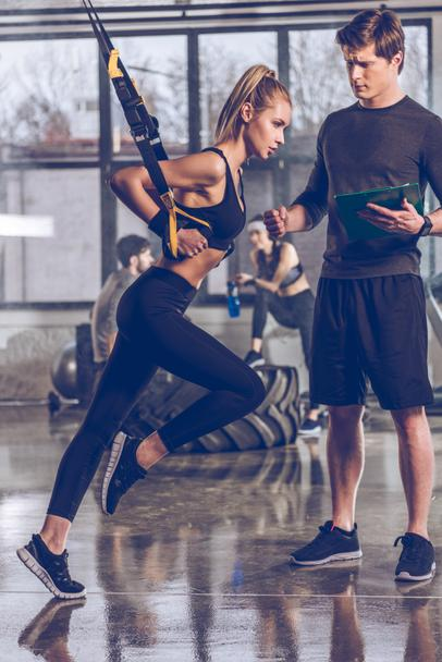 sportive woman with trx equipment - Photo, Image