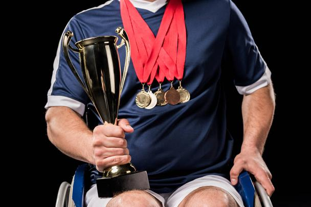 paralympic in wheelchair with trophies - Photo, Image