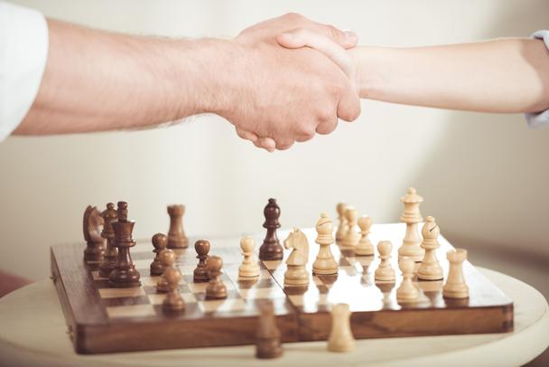 father and son shaking hands - Photo, Image