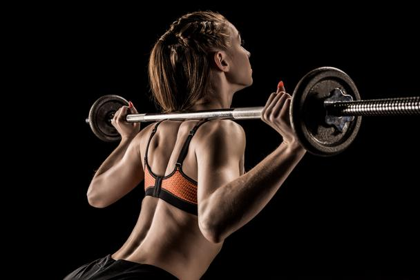 Sportswoman training with barbell  - Photo, Image