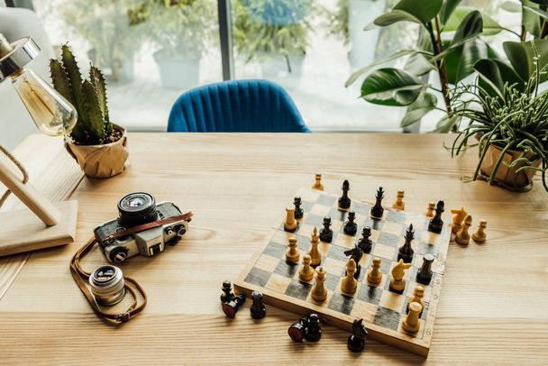 Workplace with chess set on chess board - Photo, Image