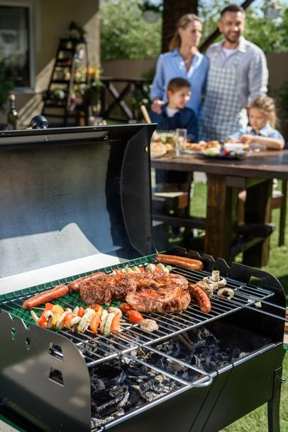 meat and vegetables cooking on grill - Photo, Image