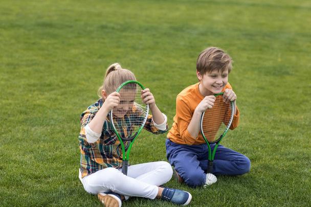 little kids with badminton equipment - Photo, Image