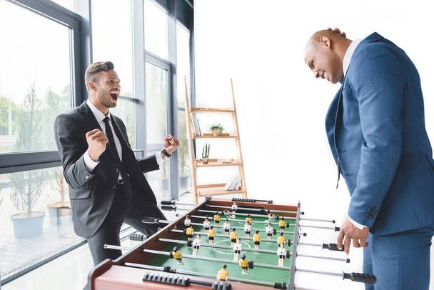 businessmen playing table football - Photo, Image