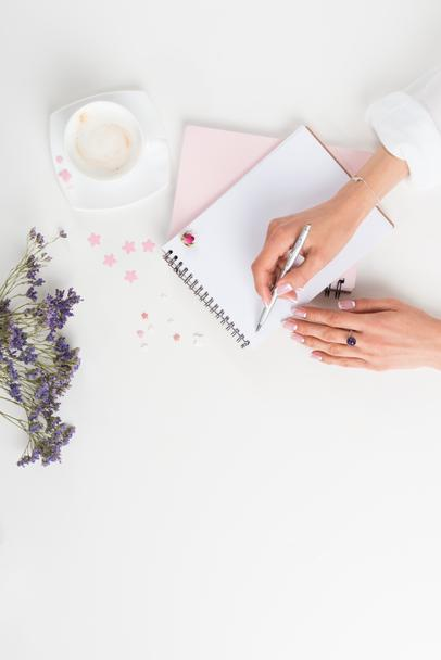 woman writing in notebook - Photo, Image