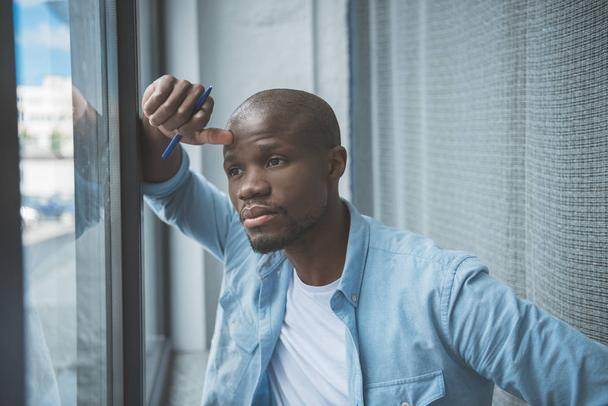 african american man looking at window - Photo, Image