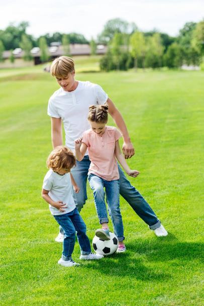 father with kids playing soccer - Photo, Image