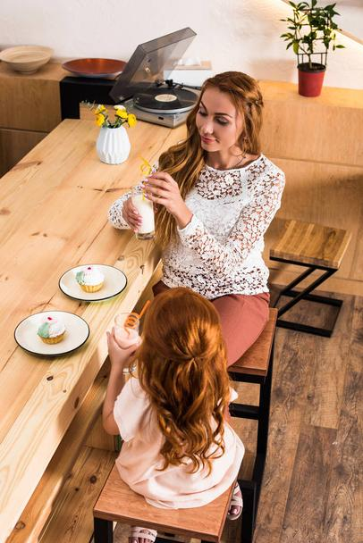 mother and daughter in cafe - Photo, Image