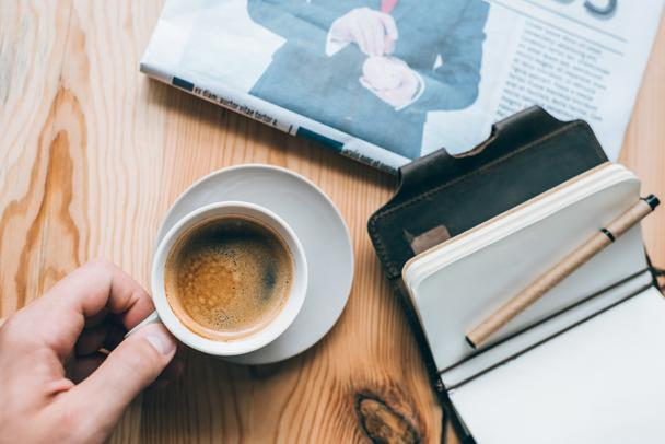 businessman with cup of coffee and notebook on table - Photo, Image