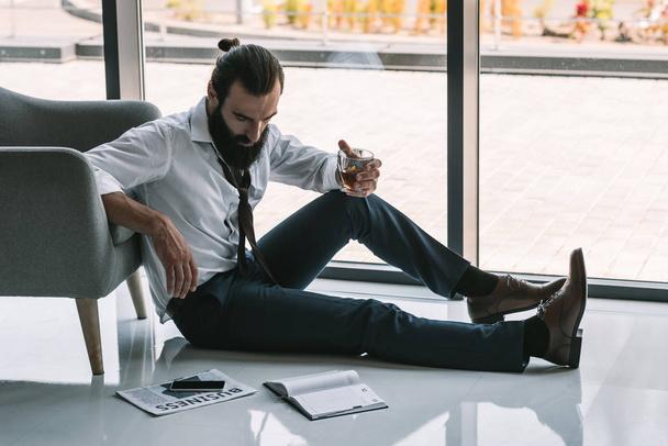 drunk businessman sitting on floor - Photo, Image