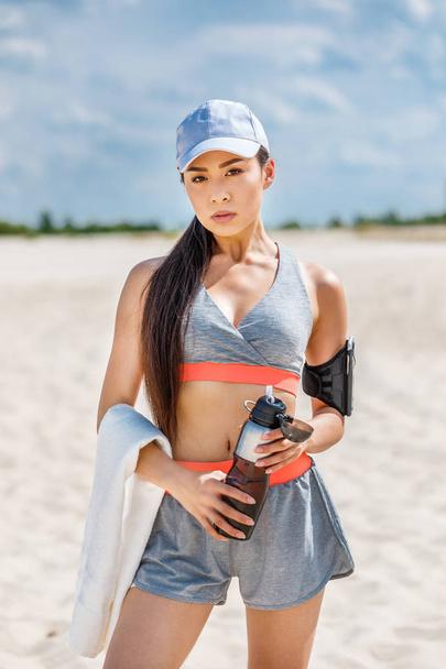 sportswoman with sport bottle - Photo, Image