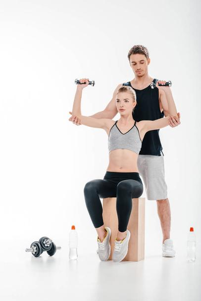girl doing exercise with trainer - Photo, Image