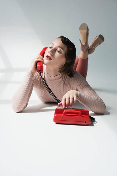 retro styled girl with rotary telephone  - Photo, Image