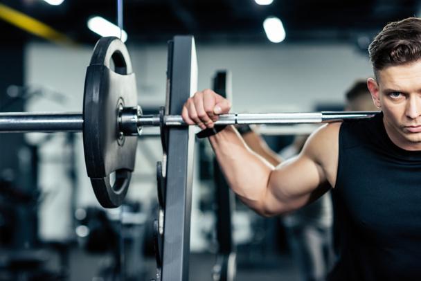 sportsman lifting barbell  - Photo, Image