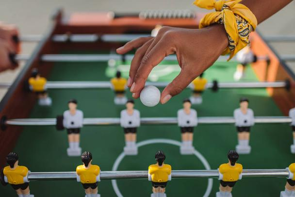 woman holding ball for table football - Photo, Image