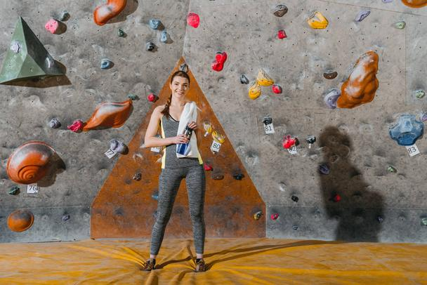 young woman in front of climbing wall - Photo, Image