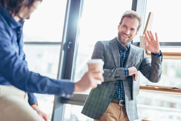 businessman waving hand to colleague - Photo, Image