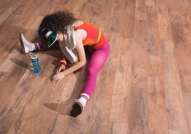 beautiful woman stretching on floor - Photo, Image