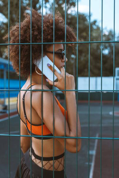 african-american woman talking on smartphone - Photo, Image