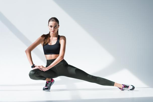 sporty woman stretching legs - Photo, Image