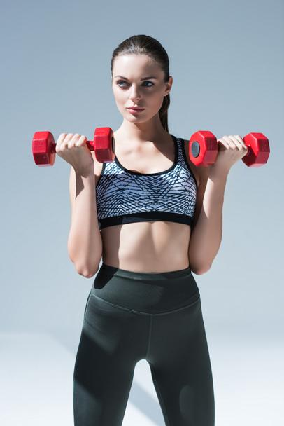 athletic girl with dumbbells - Photo, Image