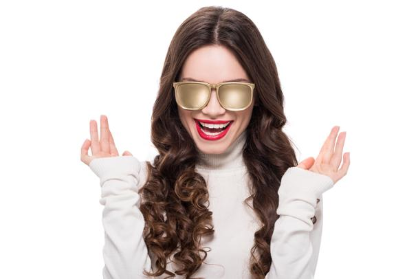 Smiling woman in gold sunglasses - Photo, Image