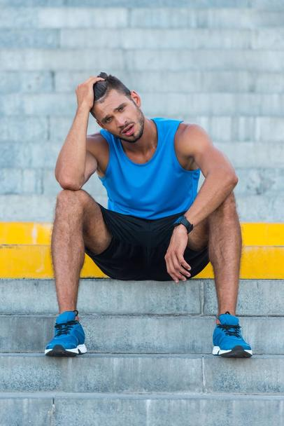 tired sportsman on stairs  - Photo, Image