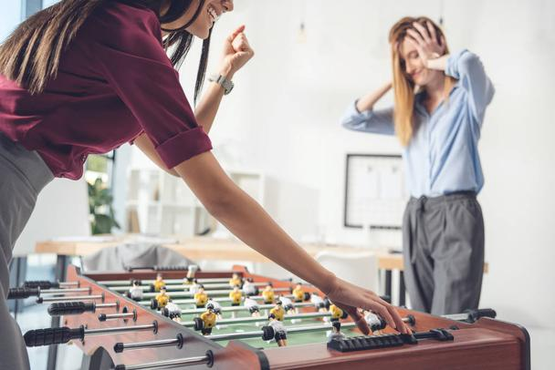 businesswomen playing table football - Photo, Image