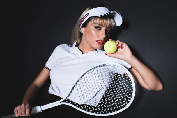 attractive woman with tennis equipment - Photo, Image