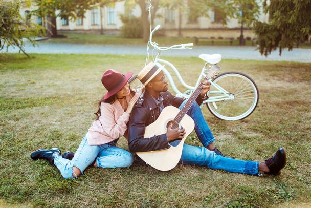 Boyfriend playing guitar for girlfriend - Photo, Image