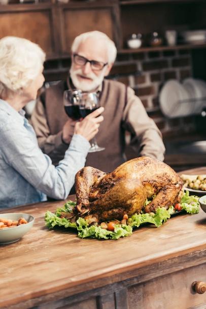 senior couple clinking glasses on thanksgiving - Photo, Image