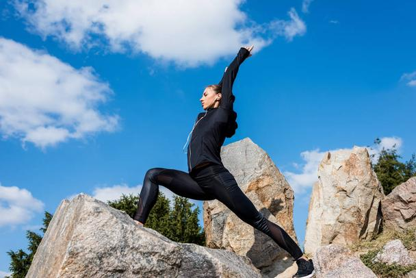 woman in warrior pose - Photo, Image