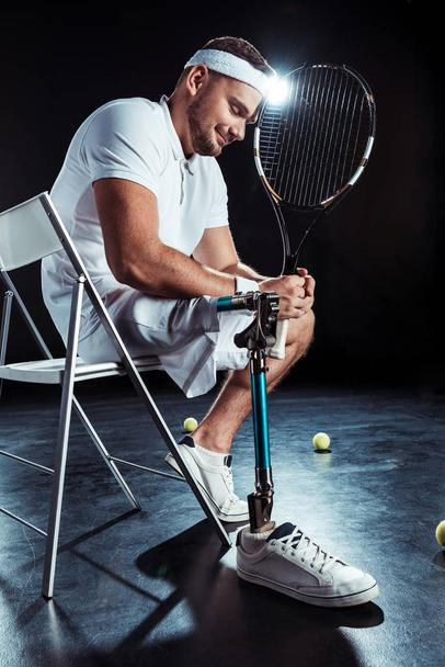 paralympic tennis player resting on chair - Photo, Image
