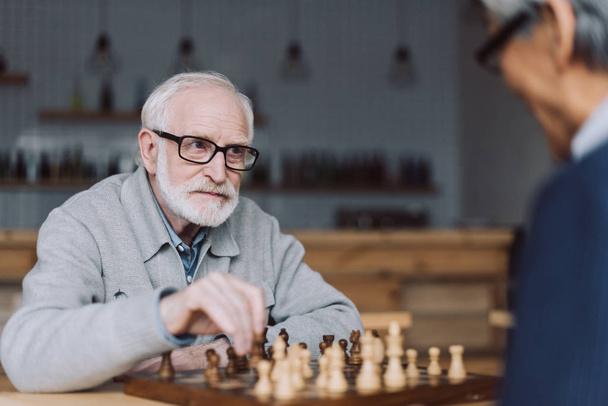 senior men playing chess - Photo, Image